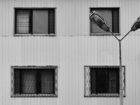 Detail photo of research base in Chernobyl showing 4 windows and part of a street light