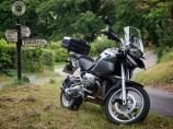 Shiny bike next to old Egbury signpost in Hampshire