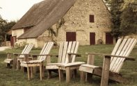 Poolside wooden chairs at campsite Les Voisins near Montaigu le Blin