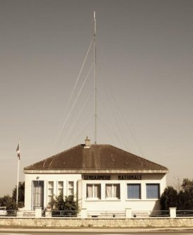 Maisonette converted into French police station complete with big antenna
