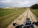 View over the bike's handlebars down an empty Ridgeway