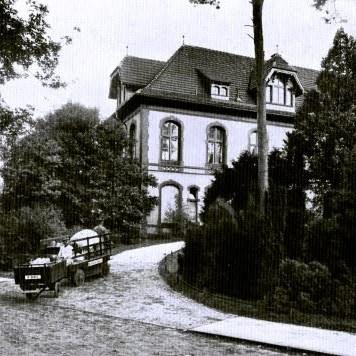 Corner-on photo of a large timber framed building