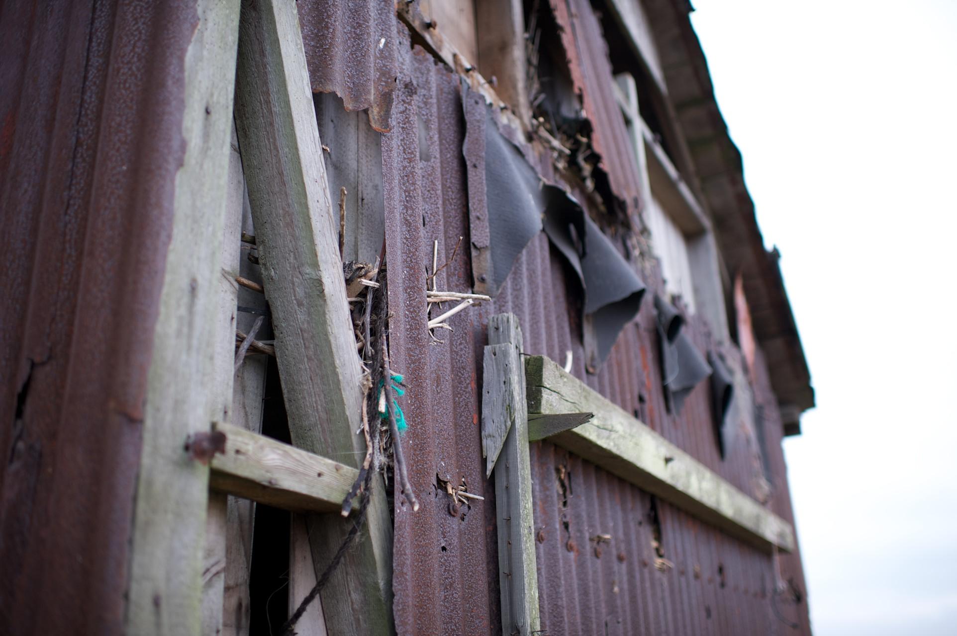 Close-up detail shot of a knackered barn door