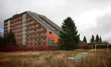Exterior view of a wedge-shaped building that's been properly trashed
