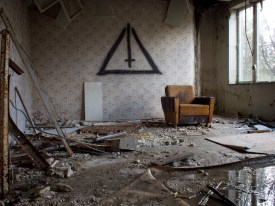Another comfy chair in a very derelict room