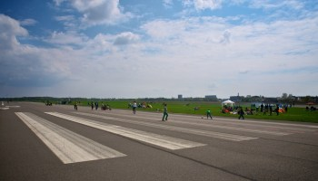 People play, cycle, and relax with BBQs at the end of runway 09R