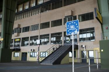 A blue sign marks the former border with the BRD - Bundesrepublik Deutschland - just off the arrivals gates