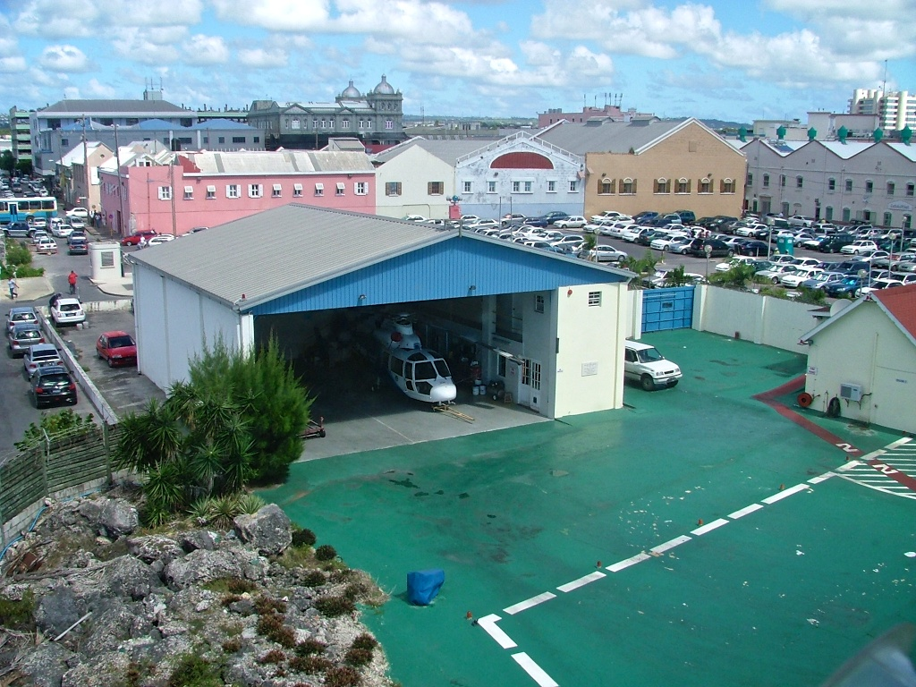 View of the hangar containing a white helicopter, taken from the air