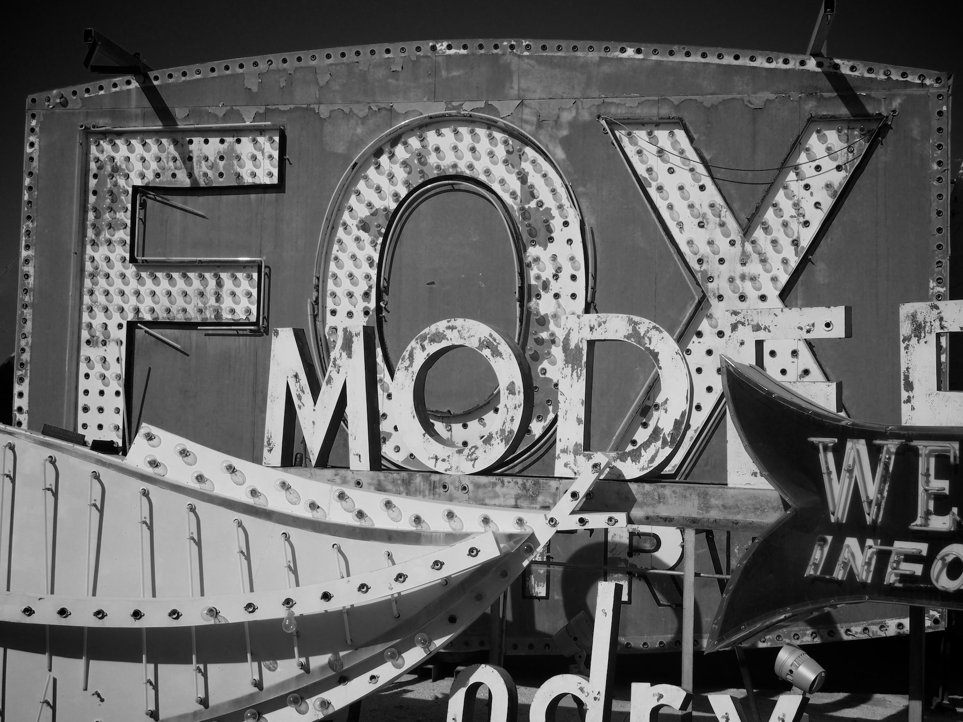 Black and White shot of some old rusting neon signs