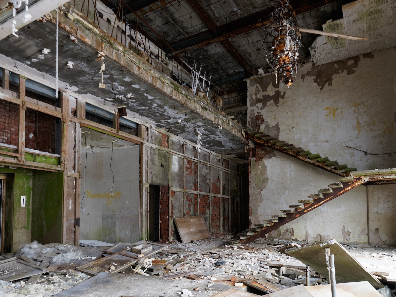 A wall-mounted staircase is all that remains of a once grand foyer