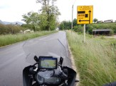Bike parked by the side of the road, looking at yet another diversion sign.