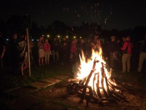 A group gathered around a bonfire