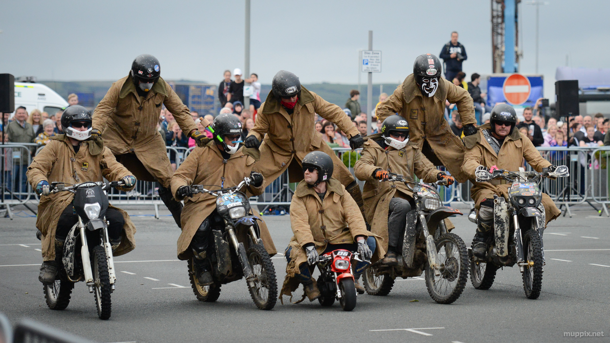 Action shot of the Purple Helmets Motorcycle Display Team