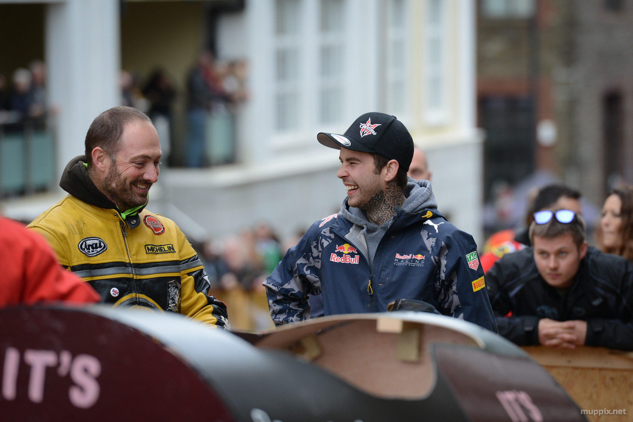 Long shot of two soapbox competitors having a conversation while waiting to start.