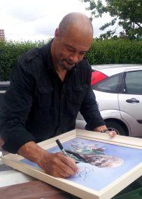 Paul McGrath signing his painting
