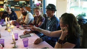 Players at the table of their steampunk seance costume party