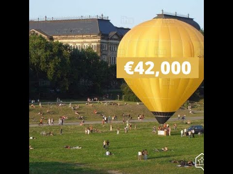 Judgement mortgage - hot air balloon on a field full of people