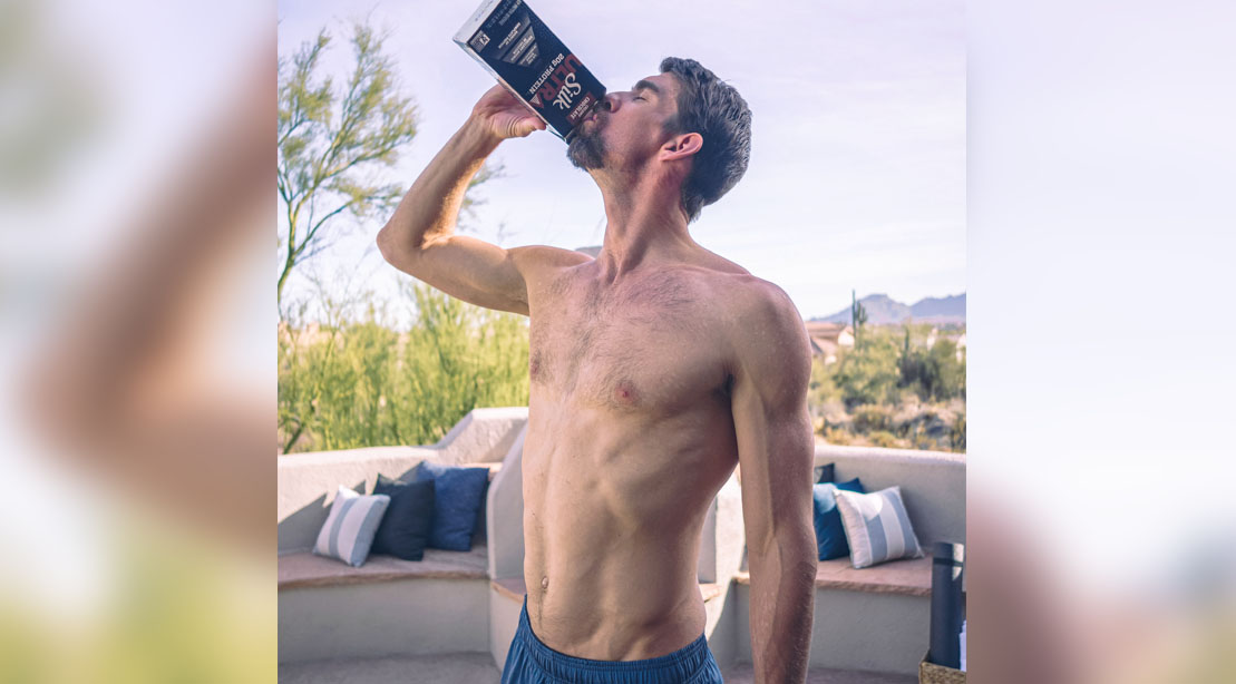 Olympic Swimmer Michael Phelps drinking a carton of Silk Ultra