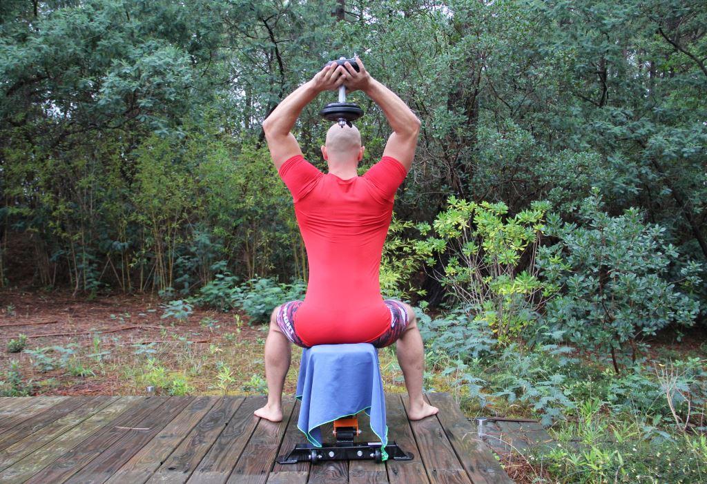 Extension nuque assis bilatéral avec haltère