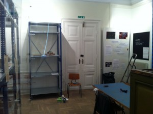 The acquisition storage rack to the left of the door