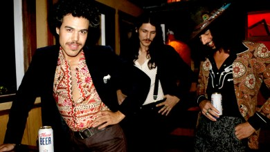 Photo of M.U.S.E. Local Artist Solar Sons: completely suited 70's era band living in the 21st century