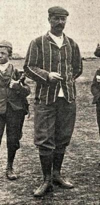 Louis Australia Whyte, in golf attire