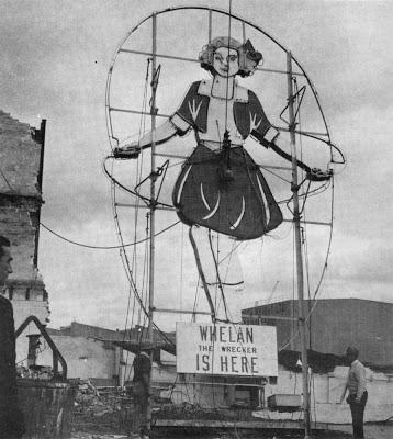Whelan the Wrecker removes the Skipping Girl Vinegar sign