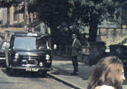 Close up of Paul Cole, a pedestrian in the background of the Abbey Road album cover