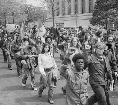 Early 70s antiwar protestors; a number are wearing army surplus clothing.
