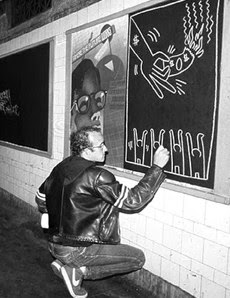 Keith Haring drawing in the subway, early 1980s