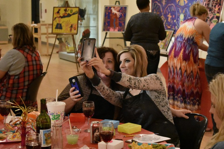 Two women posing for a quick selfie at event sponsored by Corporate Partner, Girls Gone Wine