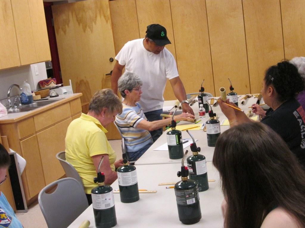 Presley Byington leading a flute-making workshop (2014)