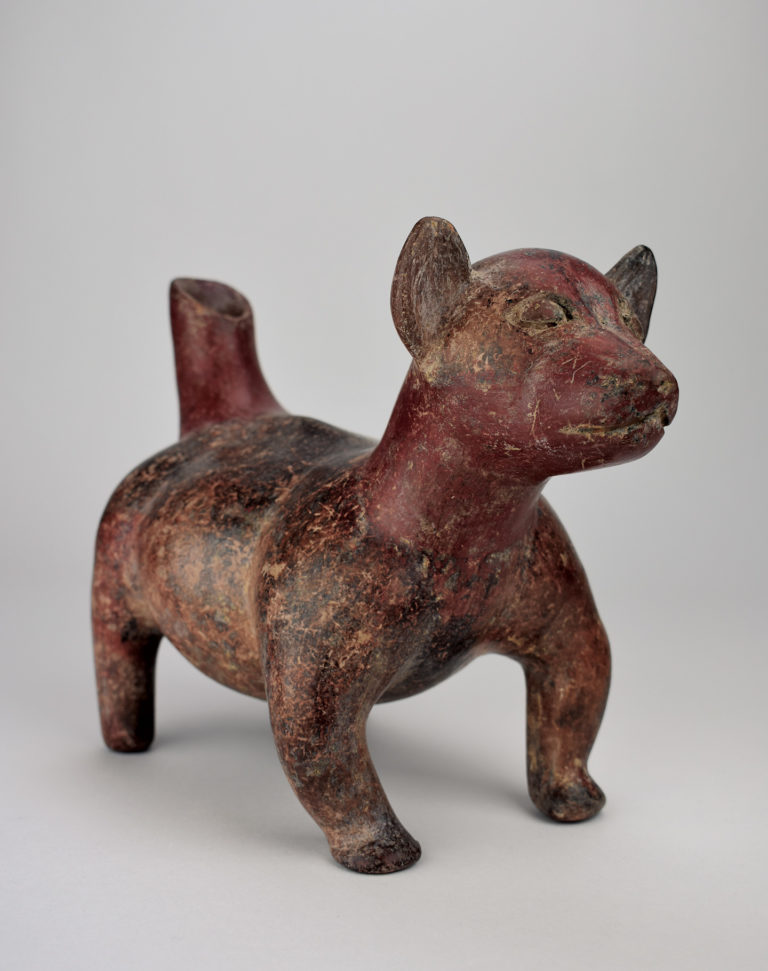 A effigy of a small chubby dog with stubby legs