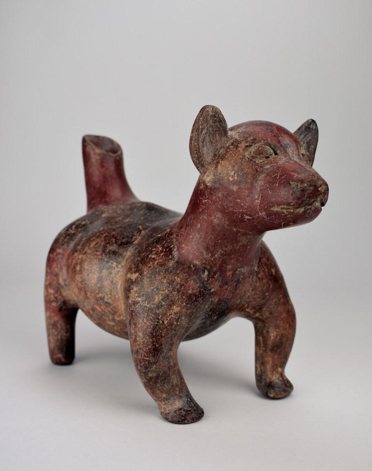 A effigy of a small chubby dog with stubby legs
