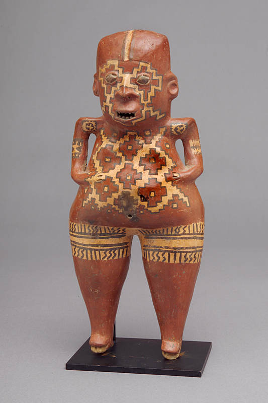 A painted effigy of a man with a large waist and small hands from Chupícuaro