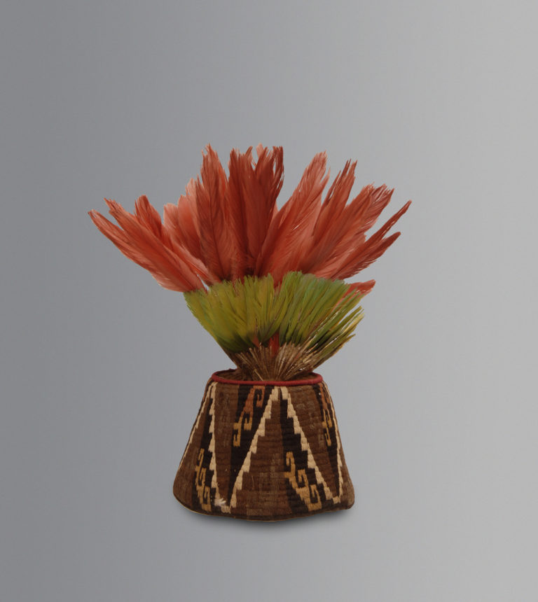 A woven fez with feathers from the Inkaic Period