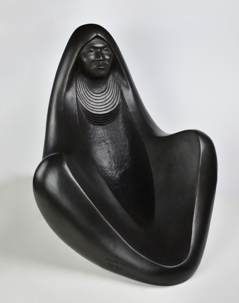 A rounded, abrascted women covered in a blanket (by Allan Houser)
