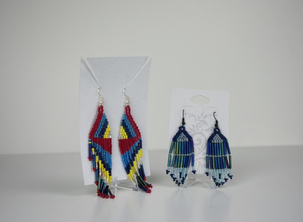 A pair of beaded earrings by Eveline Steele