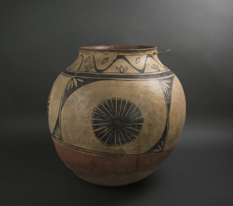 a polychrome jar divided into panels, each with a single flower motif