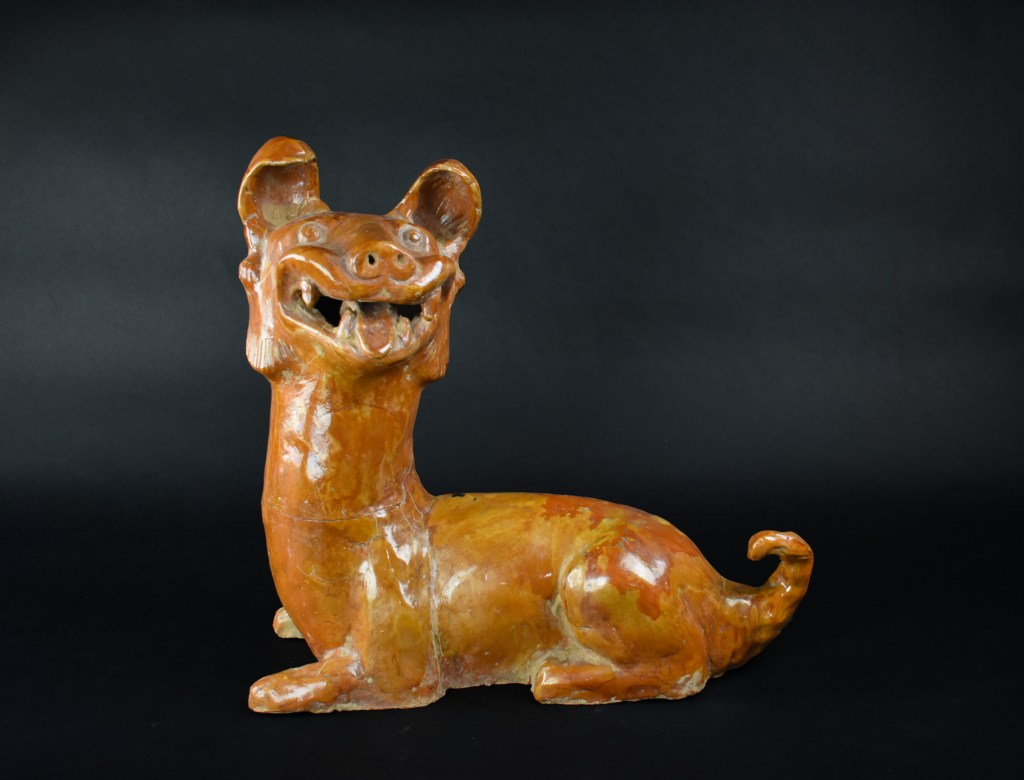 A glazed effigy of an alert dog (Han Dynasty)