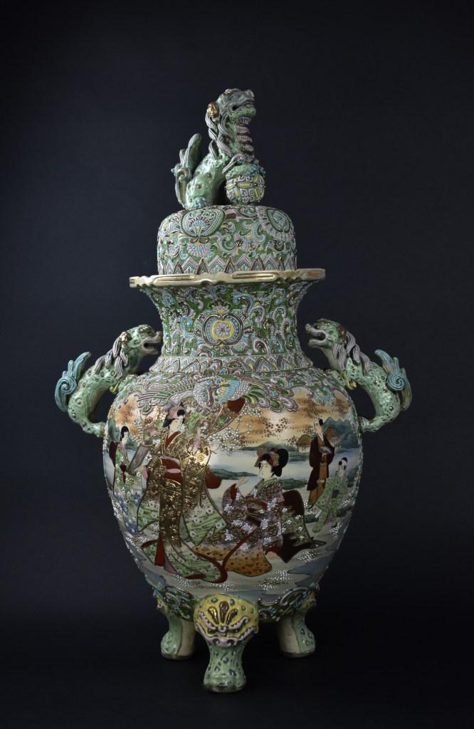 A satsuma-style jar decorated with male and female shisha