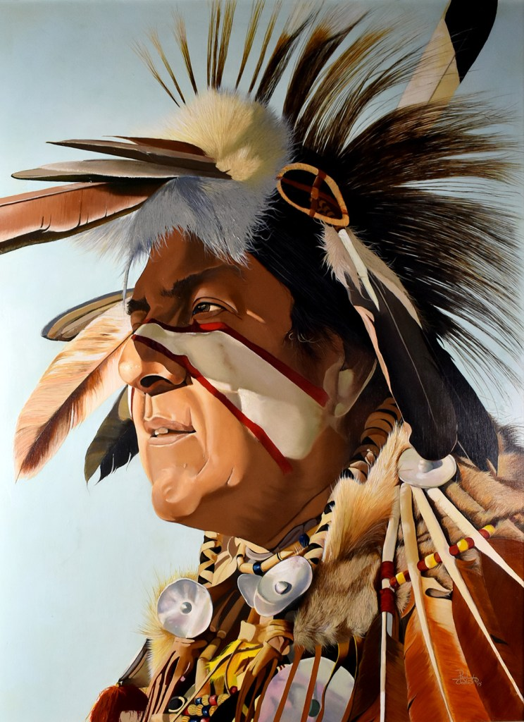 A portrait of a native man in traditional clothes with the sun in his eyes (by Paul Jones)