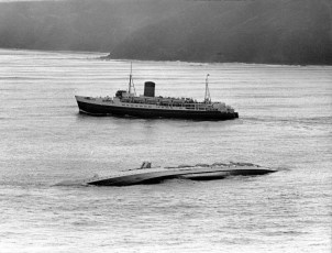 The TEV Maori passes the TEV Wahine the day after the disaster.