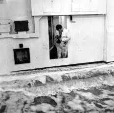 Engineer takes photograph of water on the vehicle deck