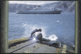 Salvors at work on wreck of TEV Wahine, with Inter Island ferry Aramoana in background.