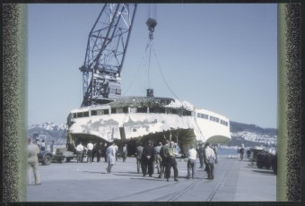 Bridge of TEV Wahine being unloaded onto Pipitea Wharf at Wellington.
