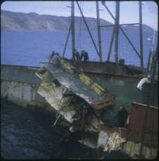A piece of the TEV Wahine wreck lifted by a crane