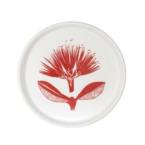 Red pohutukawa on white ceramic plate