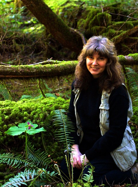 """Lorelei and a trillium, in 'Oz', """"our old growth (>250 yrs) chronosequence study plot in Polk County."""""""
