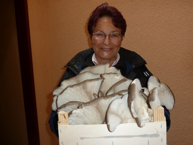 Gertrude Monnet of Switzerland happily shows off a basket containing six pounds of oyster mushrooms. Photo by Tjakko Stijve